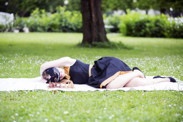 Woman  with cat mask lay on ground