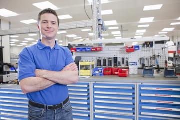 Portrait of confident technician in hi-tech manufacturing plant