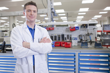 Portrait of smiling scientist in hi-tech manufacturing plant