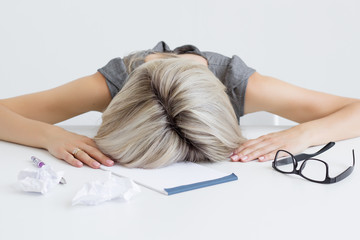 Exhausted and tired young woman sleeping on desk
