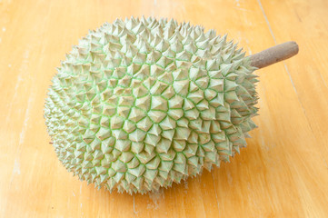 Durian fruit on wood background