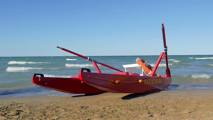 typical red rescue boat, Rimini, Italy, slow motion