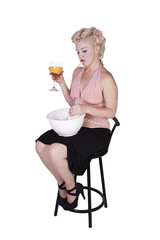 Sexy Retro Woman Cooking while Smoking and Drinking