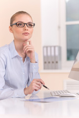 Beautiful business woman working on computer.