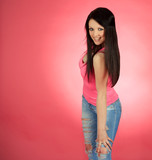 Sexual young female over pink background