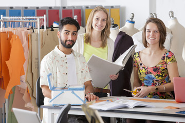 Fashion design students working together in classroom