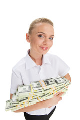 young businesswoman holding money and smiling.