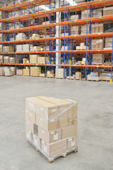 Pallet of cardboard boxes wrapped and ready in distribution warehouse