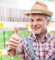 Farmer at supermarket thumbs up