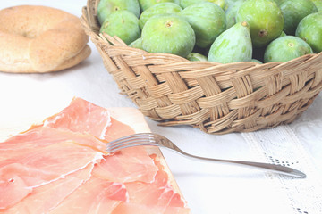 Sliced prosciutto crudo and figs
