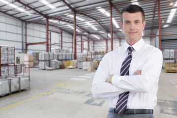 Portrait of confident businessman in warehouse