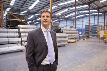 Businessman in warehouse