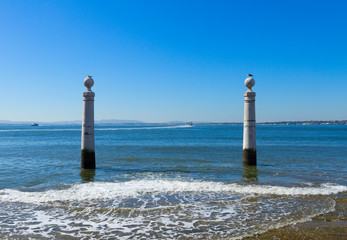 two posts at the embankment of Lisbon
