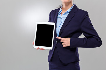 Businesswoman finger point to blank screen of digital tablet