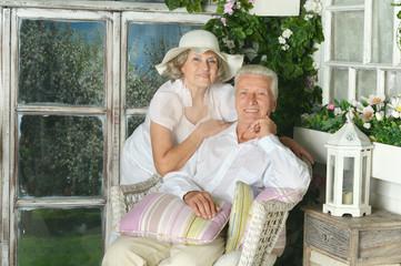 Elderly couple on wooden porch