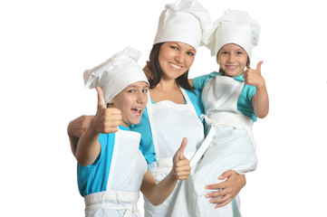 Chef with assistants showing thumbs up