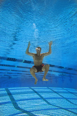 Man in swimming pool, underwater view
