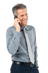 Senior Businessman Conversing On Phone