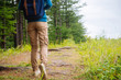 Unrecognizable hiker going on path