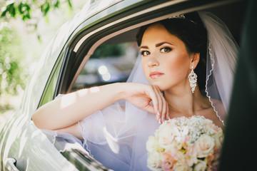 Beautiful bride in a car