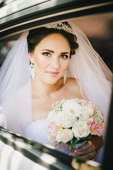 Beautiful bride in a car
