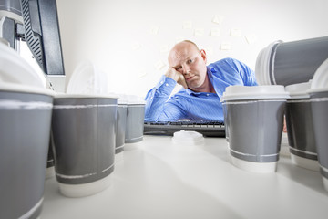 Overworked and bored businessman at office