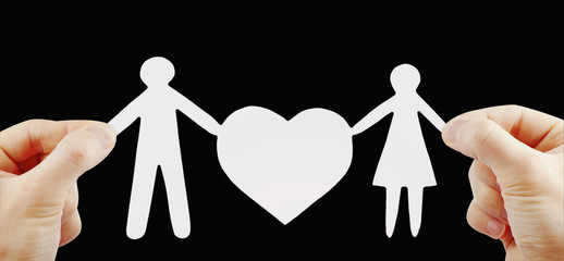 paper family with heart in hands