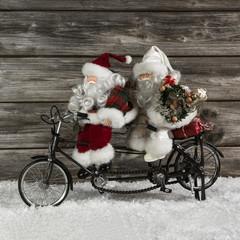 Weihnachtsgeschäft: Weihnachtskarte mit Tandem und Santa Claus