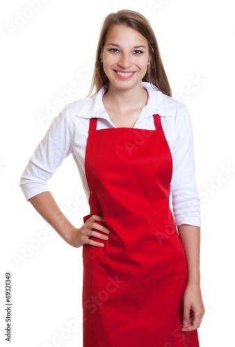 Stehende Frau mit roter Schürze - 69321349