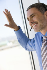 Businessman with hands-free telephone headset
