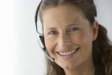 Businesswoman with hands-free telephone headset