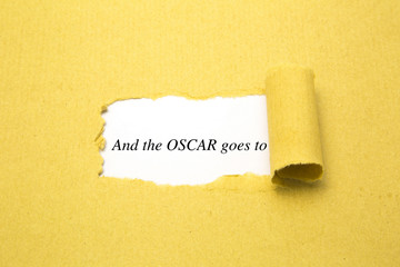 Torn brown paper with and the Oscar goes to text