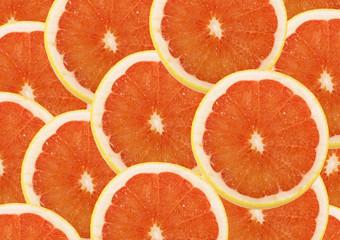 fresh grapefruit and slices background