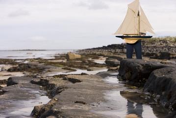 Man holding model sailboat