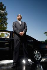 Chauffeur guarding car