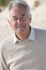 Portrait of senior man standing on beach