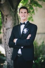 Handsome happy groom