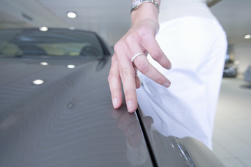 Close up of woman touching new car