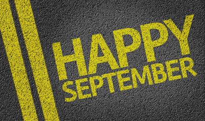 Happy September written on the road
