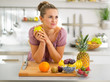 Portrait of thoughtful young housewife with fruits