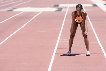 Female athlete on track, portrait
