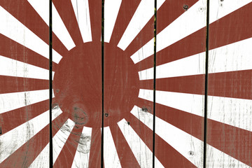 Rising Sun Flag on wooden background