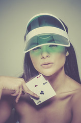 Woman holding winning poker hand