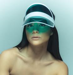 Beautiful Asian model wearing sun visor