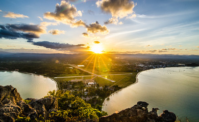 Sunset view from on top mountain see bay and city in Thailand