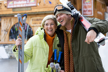 Mid adult couple with snow skis
