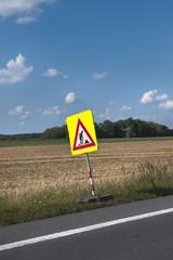 road with traffic sign work repair