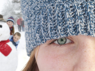 Close up of teenage girl wearing knit hat