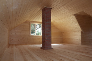 Newly built and faced attic with brick chimney