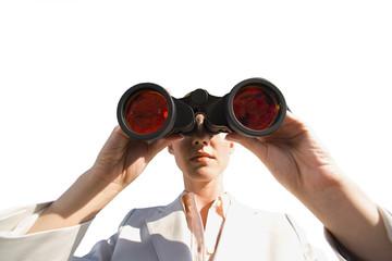 Businesswoman using binoculars close-up, cut out